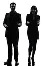 Silhouette d'homme de femme de couples d'affaires Photo stock