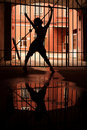 Silhouette of dancing girl in dark Stock Photo