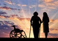 Silhouette disabled near wheelchair and peepers. Concept of a disabled person and home for elderly Royalty Free Stock Photo