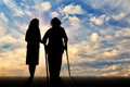 Silhouette of disabled person with crutches and peepers Royalty Free Stock Photo