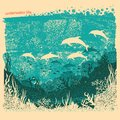 Silhouette of dolphins in Underwater sea background on old paper Royalty Free Stock Photo