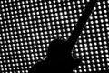 Silhouette of Electric Guitar On Lighting Grid Royalty Free Stock Photo