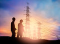 Silhouette engineer working in a building site over Blurred co