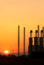 Silhouette of factory at sunset Royalty Free Stock Photos