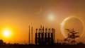 Silhouette of factory at sunset.Fantasy world.Image of earth planet. Elements of this image are furnished by NASA Royalty Free Stock Photo