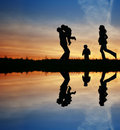 Silhouette family of four Royalty Free Stock Photo