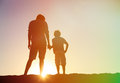 Silhouette of father and son holding hands at sunset Royalty Free Stock Photo