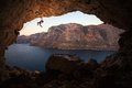 Photo : Silhouette of female rock climber on cliff in cave via  brown