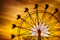 Silhouette of ferris wheel at sunset at county fair Royalty Free Stock Photo