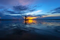 Silhouette of fisherman in wooden boat Royalty Free Stock Photo