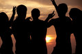 Silhouette of friends having beach party a Royalty Free Stock Photography