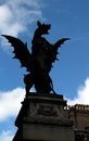 Silhouette of gargoyle in london england statue with blue sky behind Royalty Free Stock Images