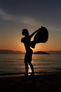 Silhouette of a girl at the beach Stock Image