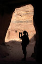 Silhouette of girl in cave Royalty Free Stock Image