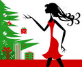 Silhouette of girl beside christmas tree holding gift Royalty Free Stock Photography