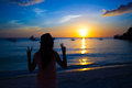 Silhouette of girl at colorful sunset on the island boracay philippines this image has attached release Stock Photo