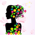 Silhouette of a girl with flowers in her hair Royalty Free Stock Images