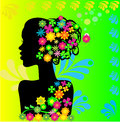Silhouette of a girl with flowers in her hair Royalty Free Stock Photography