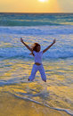Silhouette of girl, jumping in waves of ocean at s Royalty Free Stock Photo