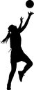 Silhouette of girl netball player competing for ball Royalty Free Stock Photo