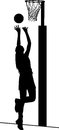 Silhouette of girl netball player shooting for goal Royalty Free Stock Photo