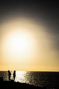 Silhouette of a girl in ocean woman jogging on the beach Royalty Free Stock Photography