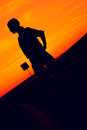 Silhouette of a girl orange sunset background Royalty Free Stock Photography