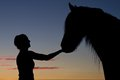Silhouette girls and horses at sunset Royalty Free Stock Photo