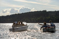 Silhouette of group of friends racing with powerboats on lake Stock Photo