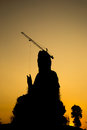 Silhouette of the guan yin goddess giant statue under twilight s compassion and mercy yim constructed in thai temple sky Royalty Free Stock Image