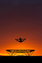 Silhouette of gymnast on trampoline in sunset Royalty Free Stock Images