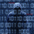 Silhouette of a hacker isloated on black with binary codes background Royalty Free Stock Image