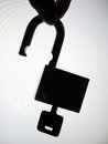 Silhouette hand picking up unlock padlock abstract security failure Royalty Free Stock Photo