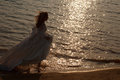 Silhouette happy bride lace dress running near waterline Stock Image