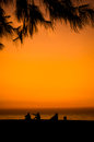 Silhouette of a happy family on the beach Stock Photos