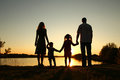 Silhouette of a happy family with children Royalty Free Stock Photo