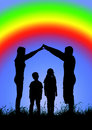 Silhouette of a happy family making the home sign on a backgroun of rainbow Royalty Free Stock Photo