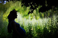 Silhouette of a happy pregnant woman in the garden Royalty Free Stock Photo