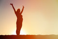 Silhouette of happy pregnant woman at sunset Royalty Free Stock Photo