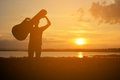 Silhouette of happy women and guitar Royalty Free Stock Photo