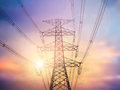 Silhouette high voltage post high voltage tower over blur sky ba background Stock Photo