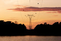 Silhouette high voltage post power transmission tower at sirindhorn dam in the morning time Stock Photos