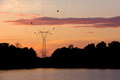 Silhouette high voltage post power transmission tower at sirindhorn dam in the morning time Royalty Free Stock Photography