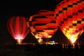 Silhouette hot air balloon landing with many people Stock Photo