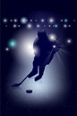 Silhouette of ice hockey player shiny background Royalty Free Stock Photos