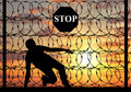 Silhouette of illegally crossing the border refugee