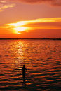 Silhouette image fisherman water golden reflection sunset Royalty Free Stock Image