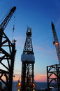 Silhouette of Jack Up Drilling Rig at Twilight T Stock Images