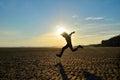 Silhouette of kid running on beach