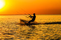 Silhouette of a kitesurfer sailing in the gulf at sunset Royalty Free Stock Photo